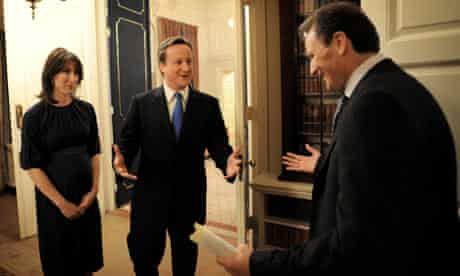 Britain's incoming Prime Minister Cameron and his wife Samantha enter 10 Downing Street in London