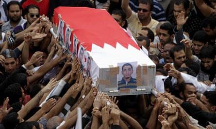 Bahraini Shiite mourners carry coffin