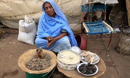 A vendor waits for customers at the market in Khartoum