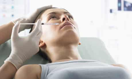 Woman Receiving Plastic Surgery Treatment in Her Lip With a Syringe