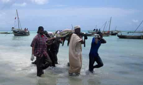 Rescuers carry bodies from Zanzibar ferry