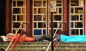 Homeless men outside theatre