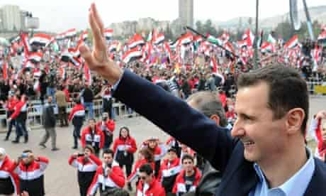 Bashar al-Assad waves to supporters