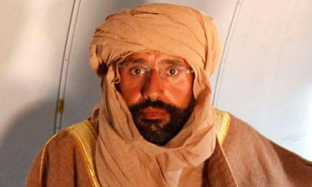 Saif al-Islam Gaddafi sitting in a plane in Zintan
