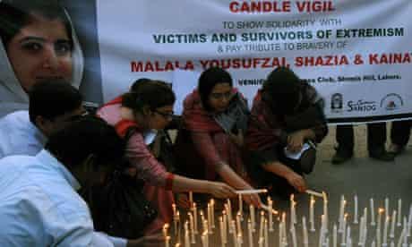 Pakistani human-rights activists light c