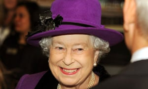 Queen Elizabeth II smiles as she talks t