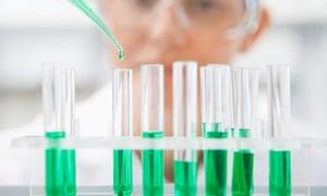 Scientist filling test tubes