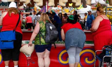 Fairgoers play a carnival game at the San Diego County Fair in Del Mar, California