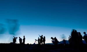 People star gazing through telescopes at a star party.