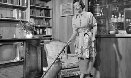 Apron housewife vacuuming den