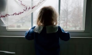 A young girl by a window