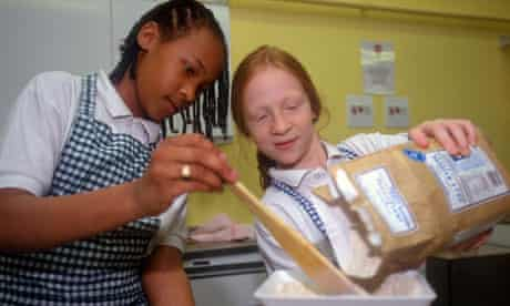 Secondary school pupils in cookery class