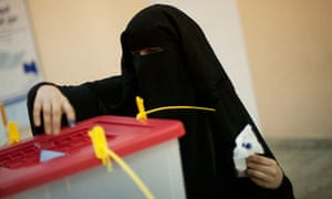A woman in a veil votes in Tripoli