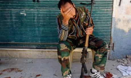 A Free Syrian Army fighter reacts after his friend was shot