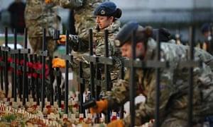 Servicewomen prepare field of remembrance