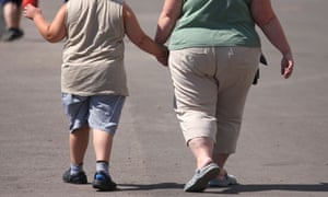 An obese mother and child
