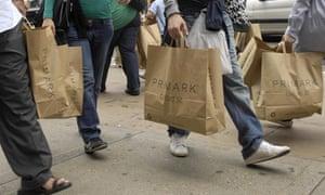 People carrying Primark bags