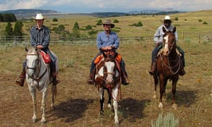 Chris McGreal on horse with sons at ranch Wyoming
