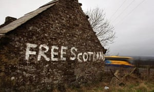 'Free Scotland' painted on cottage wall