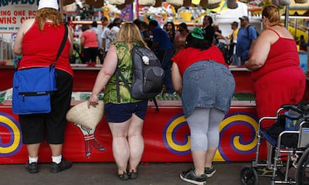 Fairgoers play a carnival game at the San Diego County Fair in Del Mar, California
