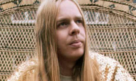Rick Wakeman at home in a wicker chair, 1970s