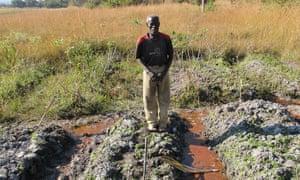 Farmer Langsu Mumbelunga in his polluted field near the Mushishima stream, Zambia.