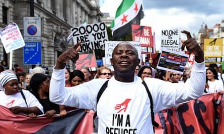 Demonstrators in London make their way down Whitehall.