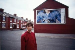 Kevin Cummins' Manchester: Liam Gallagher near Manchester City's Eastlands, 1994, by Kevin Cummins