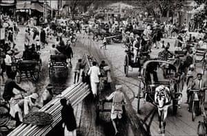 Raghu Rai: Traffic At Chawri Bazar, Delhi by Raghu Rai, 1964