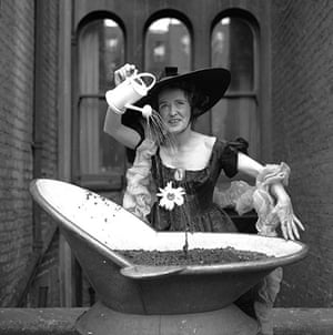 Ken Russell: Ken Russell photo of a ady in costume watering her flowers