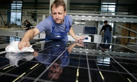 A worker cleans solar cells aat Solar World in Solar Valley, Freiburg