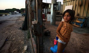 A Roma girl at an illegal camp 10km outside of Pisa, Italy