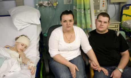 Kian Hendrich with his parents Anri and Karl
