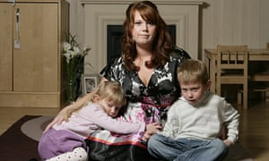 Angela Nicholls at home with her children