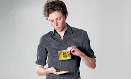 Tom Lamont holding Spice packet