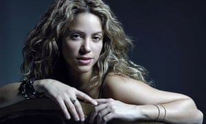 Shakira leaning over chair