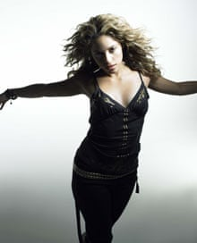 Shakira with arms outstretched