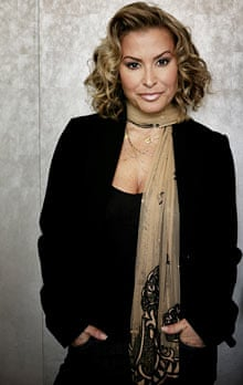 Anastacia with hands in pockets.