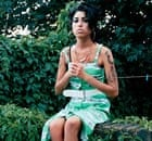 Amy Winehouse sitting on wall