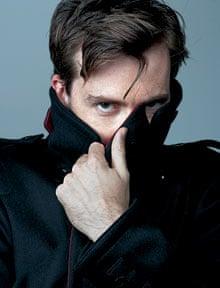David Tennant hiding behind lapel