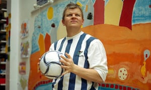 Adrian Chiles at home