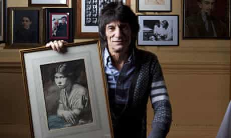 Ronnie Wood with one of his Orpen paintings
