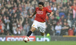 Carlos Tevez in the rain