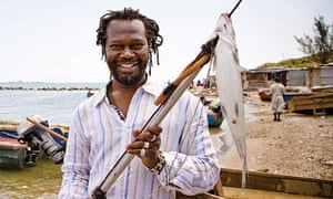 Levi Roots spears a fish
