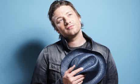 Jamie Oliver holding hat