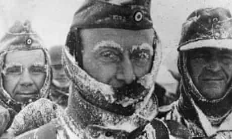 Three German soldiers covered in snow and ice