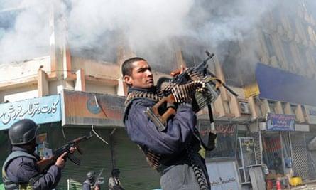 Policeman outside Kabul market building