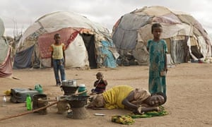 A sick woman pleads for help at the Burao camp