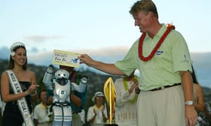 Ernie Els is presented with his winner's cheque