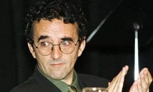 Chilean-born writer Roberto Bolano applauds during